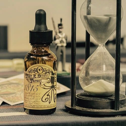 Bottle of White Octopus eJuice Next to An Hour Glass